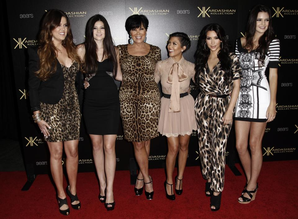 From left, Khloe Kardashian, Kylie Jenner, Kris Jenner, Kourtney Kardashian, Kim Kardashian, and Kendall Jenner pose together at the Kardashian Kollection launch party in Los Angeles, Wednesday, Aug. 17, 2011. The Kardashian Kollection designed by the Kardashian sisters is available at Sears. (AP Photo/Matt Sayles)