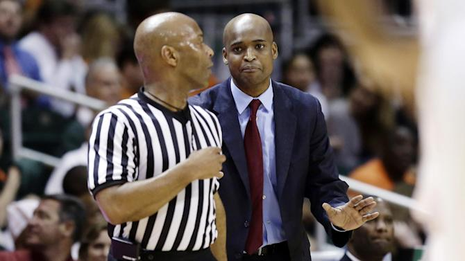 Virginia Tech head coach James Johnson looks for a foul call with an official during the first half of an NCAA college basketball game against Miami, in Coral Gables, Fla., Wednesday, Feb. 27, 2013. (AP Photo/J Pat Carter)