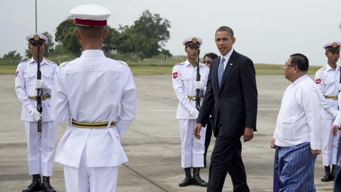 U.S. President Barack Obama walks on a red carpet as he arrives at Yangon International Airport in Yangon, Myanmar, on Air Force One, Monday, Nov. 19, 2012. This is the first visit to Myanmar by a sitting U.S. president. (AP Photo/Carolyn Kaster)