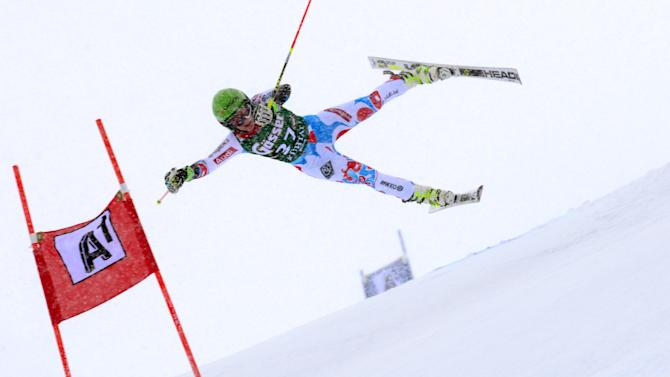 Coralie Frasse Sombet of France is airborne as she crashes during the first run of an alpine ski, women's World Cup giant slalom in Kuehtai, Austria, Sunday, Dec. 28, 2014. (AP Photo/Pier Marco Tacca)