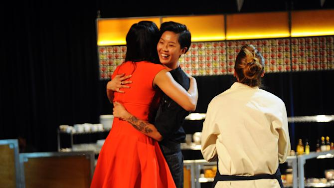 "In this publicity photo released by Bravo, judge Padma Lakshmi, left, embraces ""Top Chef: Seattle"" winner Kristen Kish, center, while contestant Brooke Williamson looks on during the show's finale that aired Wednesdays, Feb. 27, 2013. The 28-year-old chef de cuisine at Boston restaurant Stir was crowned champion of the Bravo cooking competition Wednesday after facing off against Williamson, the 34-year-old co-executive chef of Los Angeles restaurants Hudson House and The Tripel. (AP Photo/Bravo, David Moir)"