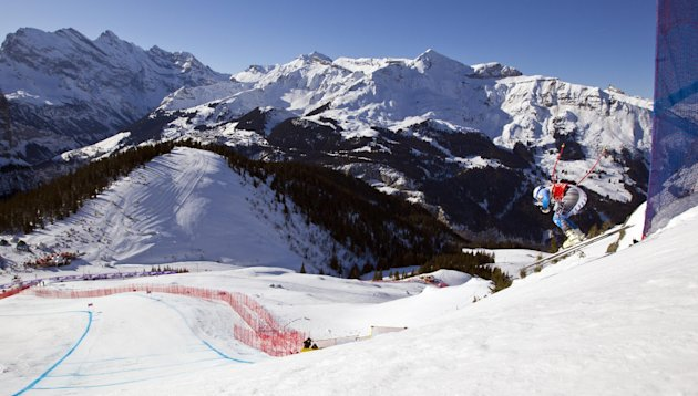 Bode Miller of USA clears the Hundschopf jump during a men's alpine skiing World Cup downhill training session in Wengen, Switzerland, Thursday Jan.  12, 2012. (AP Photo/Keystone/Alessandro Della Bell