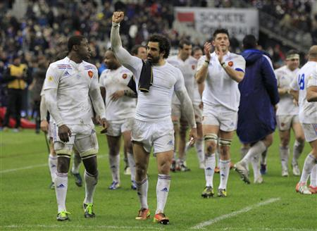 French rugby players celebrates after winning their Six Nations rugby union match against Scotland at the Stade de France in Saint-Denis