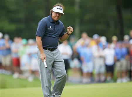 Phil Mickelson of the U.S. pumps his fist after a birdie on the 14th hole during the first round of the Deutsche Bank Championship in Norton
