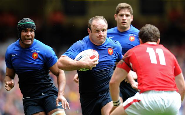 France's hooker William Servat (2nd L) vies with Wales wing George North (R) in front France's captain Thierry Dusautoir (L) during the Six Nations International rugby union match between Wales and Fr