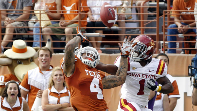 Texas safety Kenny Vacaro (4) knocks down a pass intended for Iowa State receiver Jarvis West (1) during the second quarter of an NCAA college football game at Darrell K. Royal Memorial Stadium, Saturday, Nov. 10, 2012, in Austin, Texas. (AP Photo/Michael Thomas)