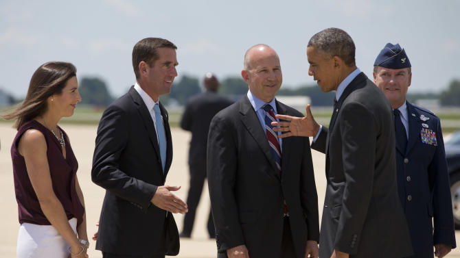 President Barack Obama shakes hands with Delaware Attorney General Beau Biden, left, next to Biden's wife Hallie Biden, far left, and Delaware Gov. Jack Markell as he arrives at New Castle Air National Guard Base in New Castle, Del., Thursday, July 17, 2014, en route to Wilmington where he is expected to visit the site of the damaged I-495 bridge in Wilmington to speak about transportation and infrastructure. (AP Photo/Jacquelyn Martin)