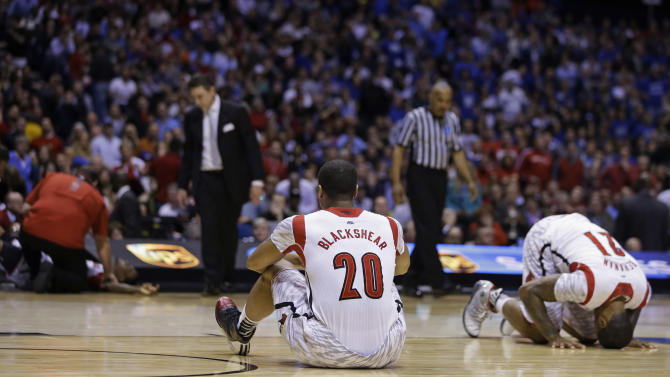 Louisville's Wayne Blackshear (20) and Chane Behanan (21) react to Kevin Ware's injury during the first half of the Midwest Regional final in the NCAA college basketball tournament, Sunday, March 31, 2013, in Indianapolis. (AP Photo/Darron Cummings)