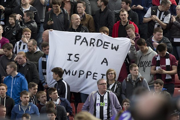 Newcastle United supporters hold up a banner critical of their manager Alan Pardew  before their team's English Premier League soccer match against St...