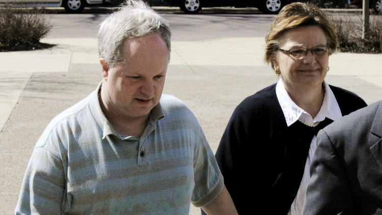 FILE - In this May 4, 2011, file photo, William Melchert-Dinkel arrives at the Rice County Courthouse in Faribault, Minn., with his wife, Joyce, for his sentencing. The Minnesota Court of Appeals on Tuesday, July 17, 2012, affirmed the convictions of the  former nurse who was found guilty of aiding the suicides of two people. (AP Photo/Jim Mone, File)