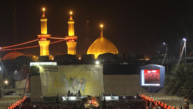 Shiite Muslim worshippers gather outside the Imam Hussein shrine, seen in the background, to mark the Muslim festival of Ashoura, an important period of mourning for Shiites in Karbala, 50 miles (80 kilometers) south of Baghdad, Iraq, Saturday Nov. 24, 2012. The festival of Ashoura commemorates the martyrdom of Imam Hussein, the grandson of Prophet Muhammad at the Battle of Karbala, Iraq, in the year A.D. 680. (AP Photo/Khalid Mohammed)
