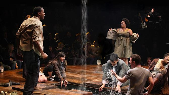 """In this theater image released by The Publicity Office, Wallace Smith, standing left, and Celisse Henderson, standing right, are shown with the company in a scene from """"Godspell,"""" in New York. Producers said Wednesday, June 13, 2012, that the hip retelling of the New Testament's Gospel of Matthew will close June 24 at the Circle in the Square Theatre.  (AP Photo/The Publicity Office, Jeremy Daniel)"""