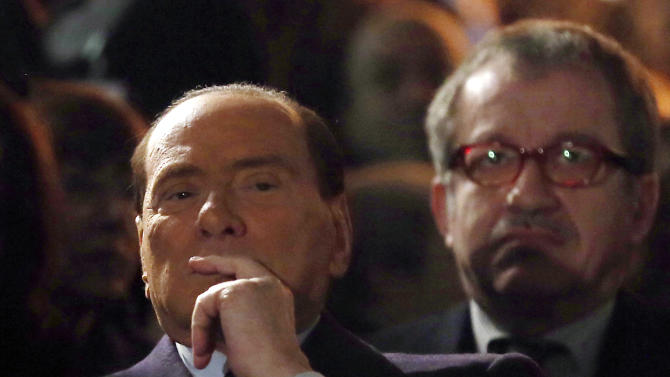 "Former Italian Premier Silvio Berlusconi, foreground, sits in front of Northern League party's leader Roberto Maroni, in Milan, Italy, Sunday, Jan. 27, 2013. Silvio Berlusconi says Benito Mussolini did much good, except for dictator's regime's anti-Jewish laws. Berlusconi also defended Mussolini for siding with Hitler, saying the late fascist leader likely reasoned that German power would expand so it would be better for Italy to ally itself with Germany. He was speaking to reporters Sunday on the sidelines of a ceremony in Milan to commemorate the Holocaust. When Germany's Nazi regime occupied Italy during World War II, thousands from the tiny Italian Jewish community were deported to death camps. In 1938, before the war's outbreak, Mussolini's regime passed anti-Jewish laws, barring them from universities and many professions, among other bans. Berlusconi called the laws Mussolini's ""worst fault"" but insisted that in many other things, ""he did good."" (AP Photo/Antonio Calanni)"