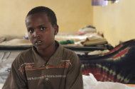 In this photo of Wednesday, July 27, 2011, nine-year-old Liban Mohammed sits in a government-run dormitory room in Mogadishu, Somalia. Liban is among more than 160 al-Shabab fighters who have defected to the government's disarmament and rehabilitation program this year. Many of the fighters are teenagers. Liban worked as a spy for the militants. (AP Photo/Jason Straziuso)
