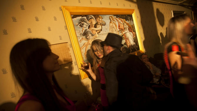 In this March. 9, 2012 photo, Russian-speaking Israelis mingle at the Soho nightclub in Tel Aviv. The club caters to the Russian-speaking immigrant community, featuring hired dancers and extravagant decorations rarely seen in informal Israel. (AP Photo/Oded Balilty)