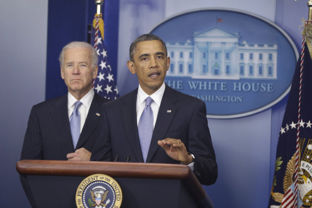 <p>               President Barack Obama and Vice President Joe Biden makes a statement regarding the passage of the fiscal cliff bill in the Brady Press Briefing Room at the White House in Washington, Tuesday, Jan. 1, 2013. (AP Photo/Charles Dharapak)