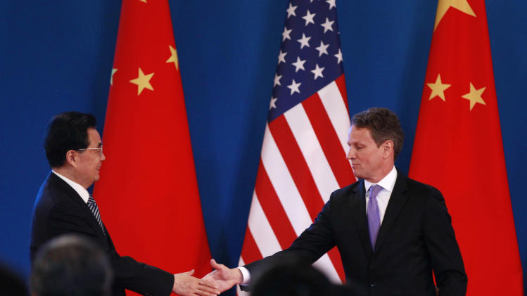 Chinese President Hu Jintao, left, shakes hand with U.S. Treasury Secretary Timothy Geithner during the opening ceremony of the U.S.- China Strategic and Economic Dialogue at The Diaoyutai state guesthouse in Beijing, Thursday, May 3, 2012. (AP Photo/Vincent Thian)