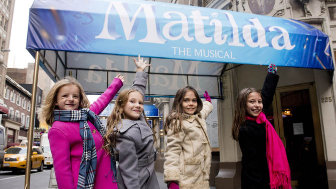 "Actors, from left, Milly Shapiro, Sophia Gennusa, Oona Laurence and Bailey Ryon, who will share the title role in ""Matilda the Musical"" on Broadway, pose for a portrait outside the Shubert Theatre, on Thursday, Nov. 15, 2012 in New York. (Photo by Charles Sykes/Invision/AP)"