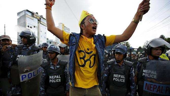 A Hindu activist chants slogans near a police line during a protest march towards parliament to demand that Nepal be declared a Hindu state in the new constitution, in Kathmandu