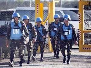 UN peacekeepers from the Philippines cross the Israeli army crossing of Quneitra between Syria to the Israeli annexed Golan Heights on June 12, 2013