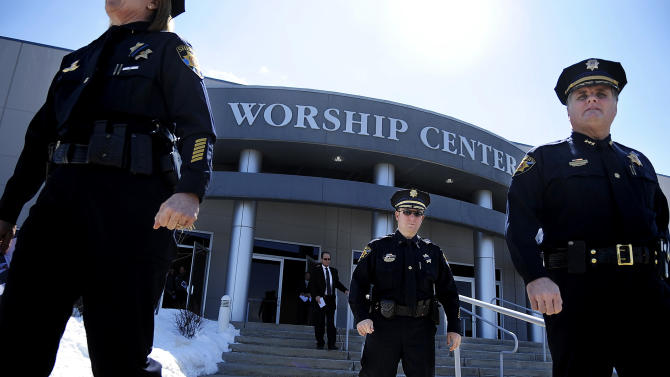 Colorado police officers leave New Life Church in Colorado Springs, Colo., after celebrating the life of Colorado prisons chief Tom Clements during a memorial service Monday, March 25, 2013 after he was gunned down as he answered the door to his home last week. (AP Photo/The Gazette, Michael Ciaglo)