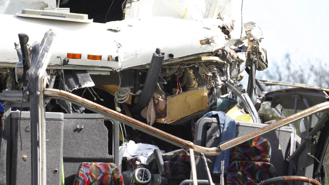 The front section of a bus that hit a concrete overpass at Miami International Airport is shown Saturday, Dec. 1, 2012 in Miami. The vehicle was too tall for the 8-foot-6-inch entrance to the arrivals area, and buses are supposed to go through the departures area which has a higher ceiling, according to an airport spokesperson. (AP Photo/Wilfredo Lee)