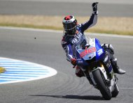 Yamaha Moto GP rider Jorge Lorenzo waves after winning third place at the Spanish Grand Prix in Jerez de la Frontera, southern Spain, May 5, 2013.  REUTERS/Marcelo Del Pozo (SPAIN - Tags: SPORT MOTORSPORT)