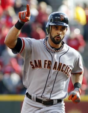 San Francisco Giants' Angel Pagan gestures as he rounds the bases after hitting a solo home run against the Cincinnati Reds in the first inning of Game 4 of the National League division baseball series, Wednesday, Oct. 10, 2012, in Cincinnati. (AP Photo/David Kohl)