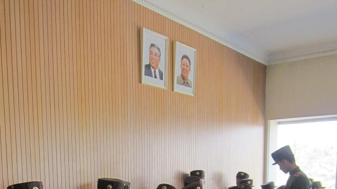 In this Thursday, April 18, 2013 photo, students at the Mangyongdae Revolutionary School in Pyongyang, North Korea, sit under portraits of the late leaders Kim Il Sung and Kim Jong Il. The school is run by the military and school administrators said it was originally set up in 1947 for children who had lost their parents during Korea's fight for liberation from its Japanese occupiers. (AP Photo)