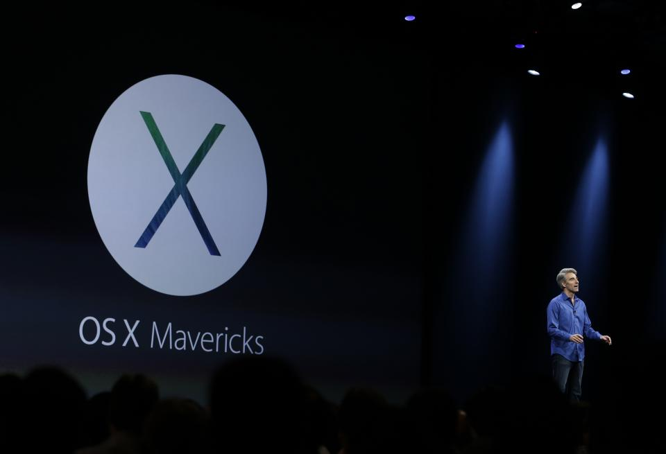 Craig Federighi, senior vice president of software engineering at Apple, introduces the new OS X Mavericks operating system during the keynote address of the Apple Worldwide Developers Conference, Monday, June 10, 2013, in San Francisco. (AP Photo/Eric Risberg)