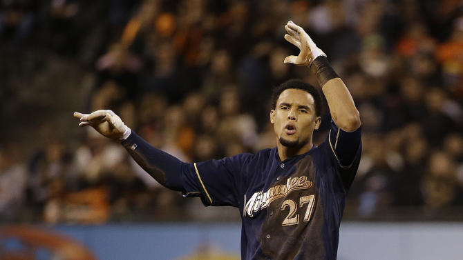 Milwaukee Brewers' Carlos Gomez (27) throws his helmet after an officials' review called him out stealing second during the ninth inning of a baseball game against the San Francisco Giants, Monday, July 27, 2015, in San Francisco. The Giants won 4-2. (AP Photo/Jeff Chiu)