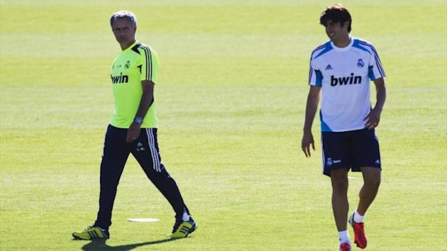 Real Madrid coach Jose Mourinho walks past Kaka during a training session at Real Madrid's training grounds in Valdebebas (Reuters)