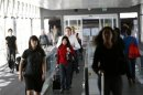 Airline passengers head to a flight at San Francisco International Airport