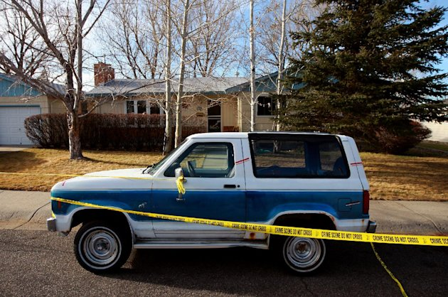 Crime scene tape surrounds he home of Casper College professors Jim Krumm and Heidi Arnold on Saturday, Dec. 1, 2012 in Casper, Wyo. The couple were killed by Krumm's 25-year-old son Chris Krumm on Friday morning. Arnold died from knife wounds on the street in front of the house, after which Chris Krumm killed his father and himself in a Casper College classroom. (AP Photo/The Casper Star-Tribune, Alan Rogers) MANDATORY CREDIT; TRIB.COM