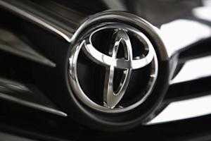 A Toyota logo is seen on a car inside a showroom at a Toyota dealership in Warsaw