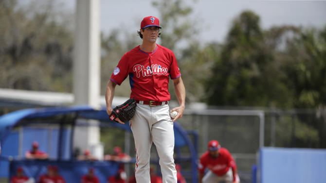 Philadelphia Phillies starting pitcher Cole Hamels stands on the mound after walking a batter in an exhibition baseball game against the Toronto Blue Jays in Dunedin, Fla., Thursday, March 26, 2015. (AP Photo/Kathy Willens)