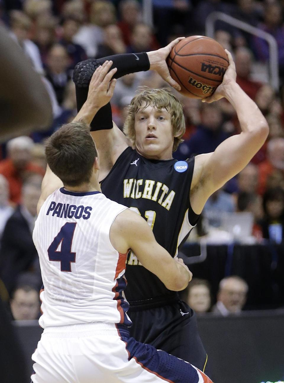 Gonzaga's Kevin Pangos (4) guards Wichita State's Ron Baker (31) in the first half during a third-round game in the NCAA men's college basketball tournament in Salt Lake City Saturday, March 23, 2013. (AP Photo/Rick Bowmer)
