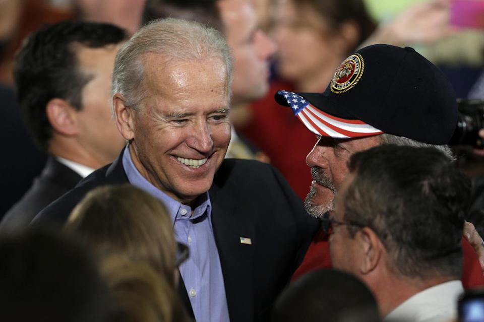 Vice President Joe Biden greets supporters after speaking at a campaign rally at the Municipal Auditorium in Sarasota, Fla., Wednesday, Oct. 31, 2012. (AP Photo/Matt Rourke)