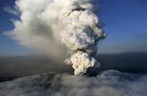 A column of steam and ash rises out of an erupting volcano near Eyjafjallajokull