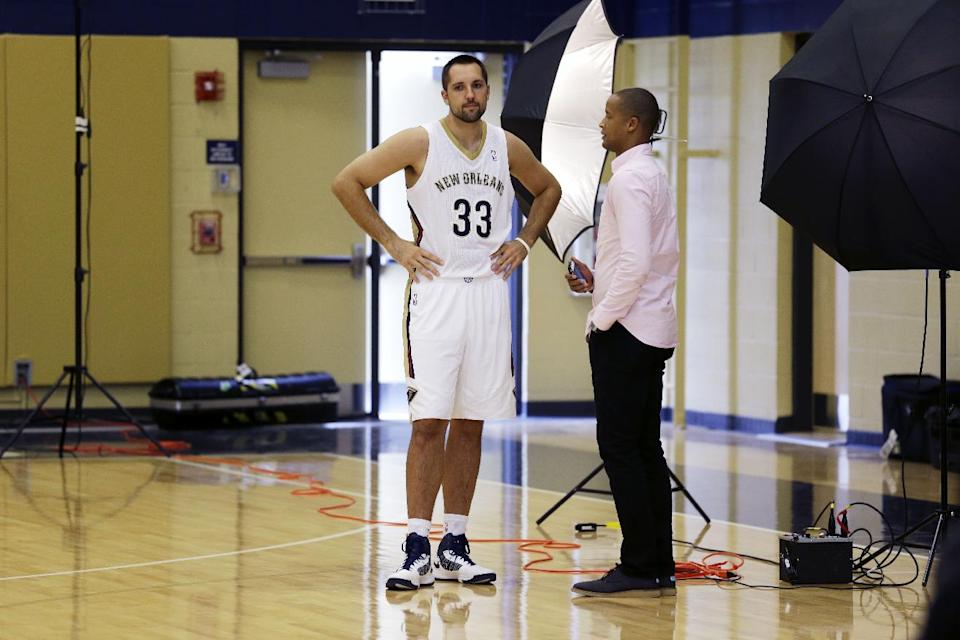 New Orleans Pelicans power forward Ryan Anderson (33) stands away from the media at their NBA basketball media day in Metairie, La., Monday, Sept. 30, 2013. (AP Photo/Gerald Herbert)