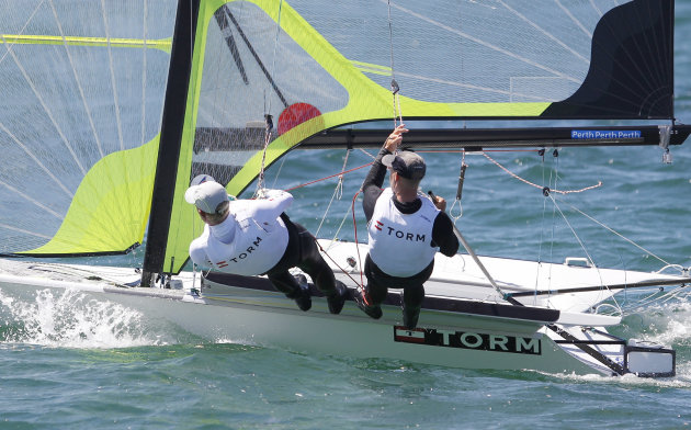 Denmark's Allan Christensen Noerregaard and Peter Lang compete during the Men's 49er skiff gold medal race at the Sailing Championships in Perth, Australia, Sunday, Dec. 18, 2011. (AP Photo/ Theron Ki