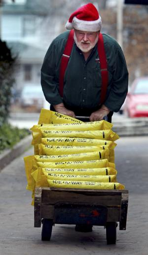 Roger McCreight, a hardware store employee, brings up the remaining bags of rock salt from the basement inventory to stock in the store for customers Monday, Dec. 24, 2012, in Maplewood, Mo., in anticipation of wintry weather. (AP Photo/St. Louis Post-Dispatch, Laurie Skrivan) EDWARDSVILLE OUT  ALTON OUT