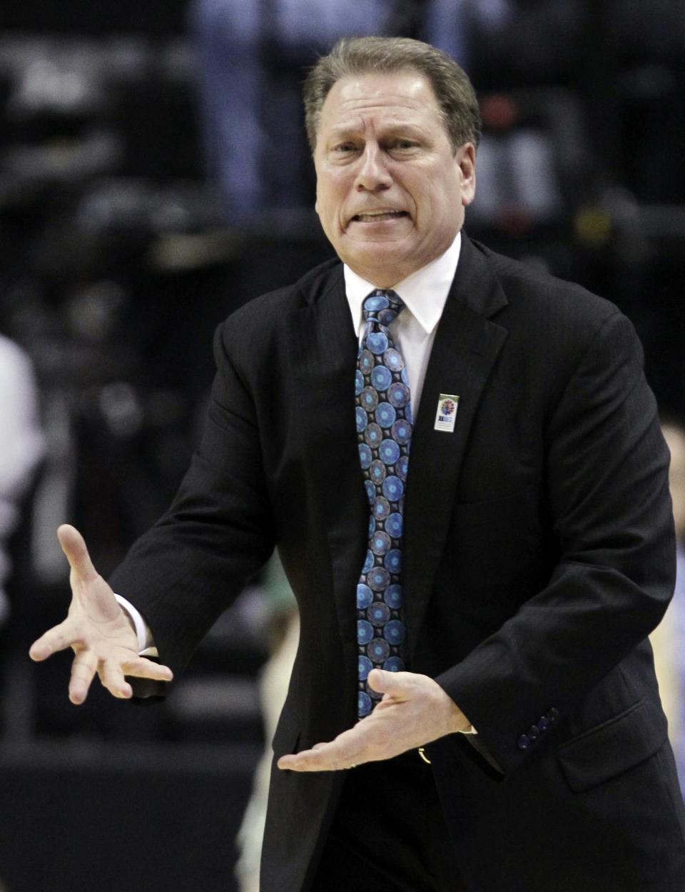 Michigan State head coach Tom Izzo directs his team in the first half of an NCAA college basketball game against Iowa in the second round of the Big Ten Conference tournament in Indianapolis, Friday, March 9, 2012. (AP Photo/Michael Conroy)