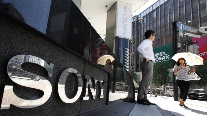 "A woman walks by Sony Building in Tokyo's Ginza shopping district in Tokyo, Tuesday, June 28, 2011. Sony Corp. Chief Executive Howard Stringer says PlayStation Network gamers are ""very loyal"" and returning to the service in big numbers, as he sought to reassure shareholders following a series of embarrassing hacker attacks.(AP Photo/Shizuo Kambayashi)"