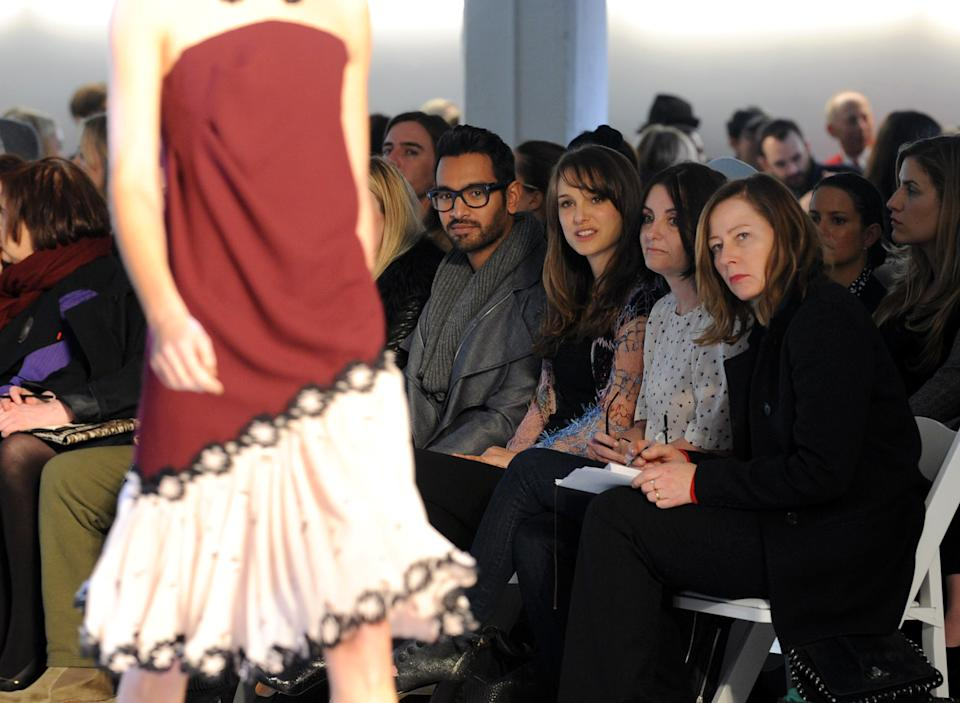 Natalie Portman, seated third from right, watches the Rodarte Fall 2012 show during Fashion Week in New York, Tuesday, Feb. 14, 2012. (AP Photo/Diane Bondareff)