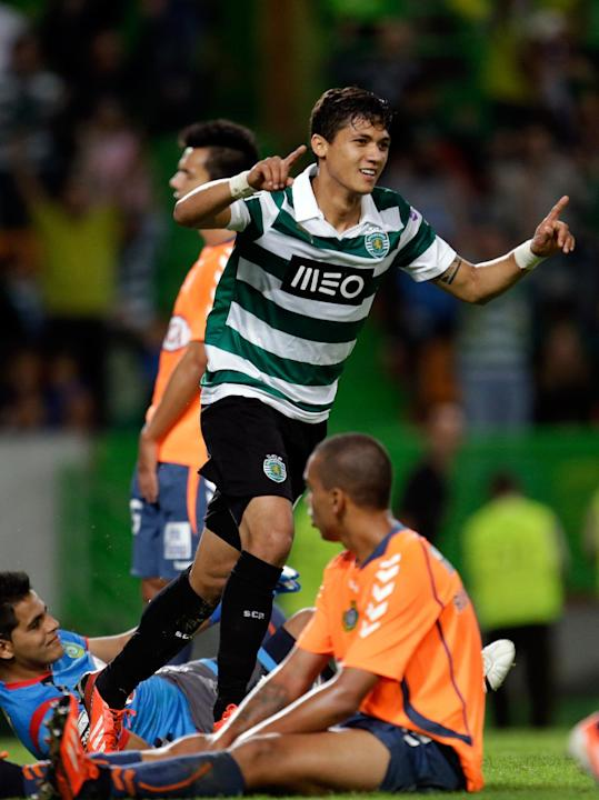 Sporting's Montero, from Colombia,  celebrates after scoring his second goal against Setubal  during their Portuguese league soccer match Saturday, Oct. 5 2013, at Sporting's Alvalade stadium in Lisbo
