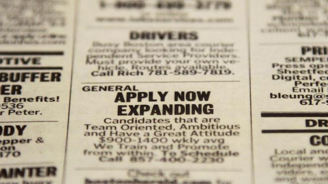 FILE - In this Tuesday, Dec. 11, 2012 file photo, an advertisement in the classified section of the Boston Herald newspaper calls attention to possible employment opportunities in Walpole, Mass. Economists forecast that employers added 155,000 jobs in December, according to a survey by FactSet. That would be slightly higher than November's 148,000. The unemployment rate is projected to remain at 7.7 percent.  (AP Photo/Steven Senne, File)