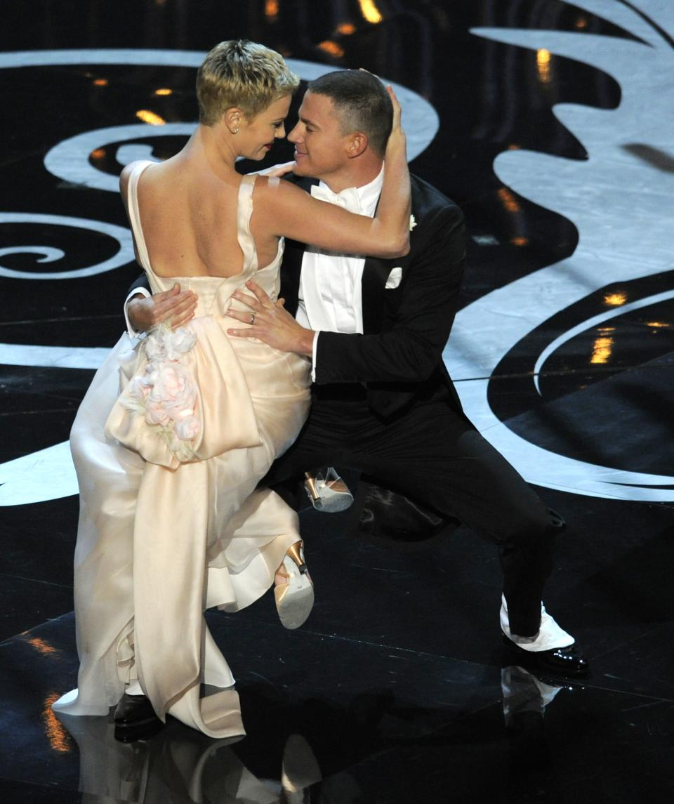 Channing Tatum, right, and Charlize Theron perform during the Oscars at the Dolby Theatre on Sunday Feb. 24, 2013, in Los Angeles.  (Photo by Chris Pizzello/Invision/AP)