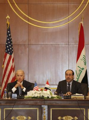 U.S. Vice President Joseph Biden, left, and Iraqi Prime Minister Nouri al-Maliki, right, hold a joint news conference in Baghdad, Iraq, Wednesday, Nov. 30, 2011. Biden said Wednesday that his trip to Baghdad ahead of the U.S. military pullout will mark a new beginning between Iraq and the United States, but already protests in Iraq against his visit are demonstrating the difficulties the relationship will face. (AP Photo/ Khalid Mohammed)