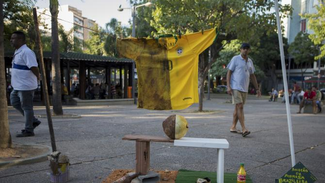 An exhibition of a Brazil national soccer jersey shows the two economic extremes of the sport in Rio de Janeiro